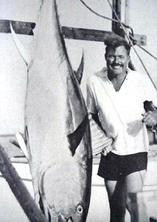 Ernest Hemingway with a prized Tuna caught off of Bimin
